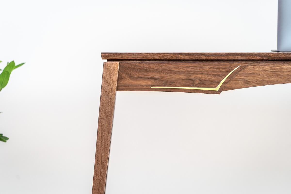 Close up of brass on the walnut & brass writing desk Pedulla Studio