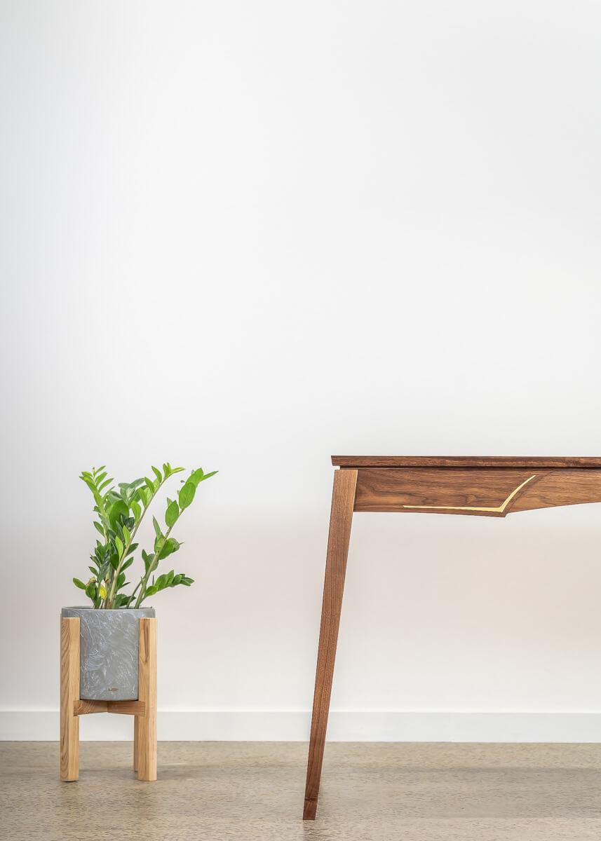 leg view of walnut & brass writing desk Pedulla Studio