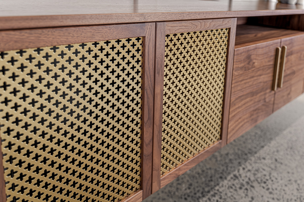 Walnut and brass entertainment unit close up of brass grille Pedulla Studio