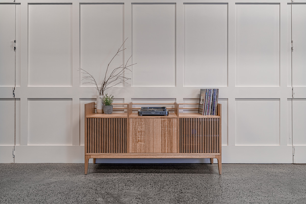 Tasmanian Oak Record Cabinet with a plant and branches Pedulla Studio
